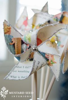 Fun with Dick and Jane - vintage book pages and a little glitter = pinwheel fun
