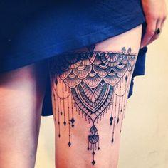 Thigh tattoo: garter/chandelier style.