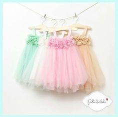 Tulle baby dresses....I love the green one!! :)