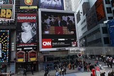 A screen shows Whitney Houston's funeral in Times Square on February 18, 2012 in New York City. Whitney Houston was found dead in her hotel room at The Beverly Hilton hotel on February 11, 2012.