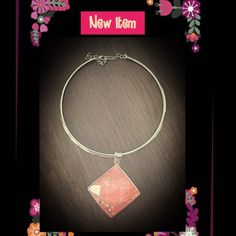 Silver adjustable choker with pink glass gem New with out tags... This choker is adjustable for the perfect fit. The pink glass gem in the middle is a very bright, beautiful piece.! The slide can come off of the choker and can be worn by itself or you can add other slides to it. Great, versatile, piece! Jewelry Necklaces