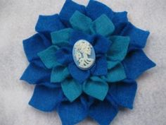 My personal favorite! Teal and blue dahlia hair flower with a blue and white skull cameo. <3 $8 on my Zibbet shop!