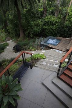 Stairs leading from upper decks to hidden spa surrounded by woodland environment designed by Mark Tessier Landscape Architecture, MTLA, Inc.