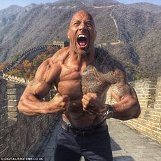 'Great ruler': Dwayne 'The Rock' Johnson showed off his muscles on the Great Wall of China...
