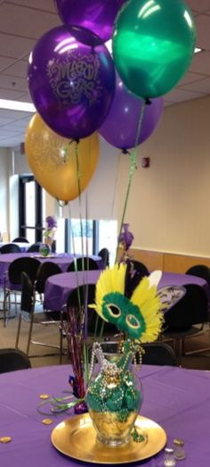What if we just tied a mask to some balloons and sprinkled the coins on the tables I posted? That seems like an easy centerpiece idea. Mardi Gras centerpiece
