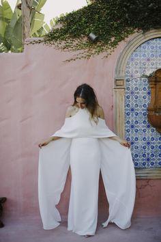 cold-shoulder wedding dress with cape by Carla Zampatti