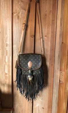 6b5fb8e9078a Vintage Swag Fringed Vintage Louis Vuitton Saint Cloud GM. Dark brown  leather fringe and leather