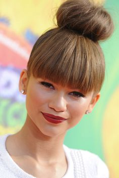 Zendaya spiced up her high bun with blunt bangs at Nickelodeon's Kid's Choice Awards in 2014.   - Seventeen.com