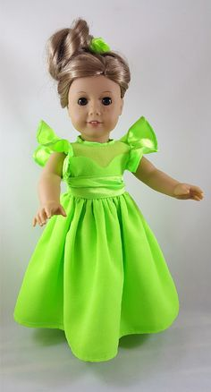 18 inch doll princess style long gown is made of lime green sparkly sheer over polyester satin with attached sash. Dress has lined scalloped bodice with ruffled sleeve and back Velcro closure for easy on/off. Coordinating hair clip has attached handmade rose flower with vintage crystal