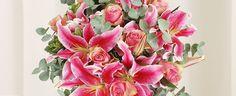 Klassieke rozen en lelie boeket