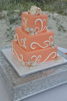 Coral colored cake - shell/beach theme.