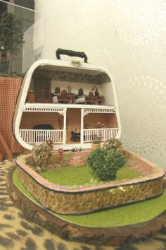 """There's a Thomas Dolby song that goes """"I live in a suitcase,"""" and this dollhouse makes it possible."""