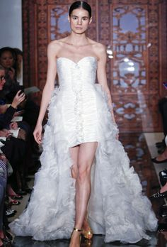 The draped organza train on this mid-thigh sheath by Reem Acra exemplifies a modern take on the short wedding gown trend