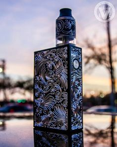 "Isn't she beautiful? We picked up a few high end combos that includes the Plaque Box Mod & Triad +2 Genesis RDTA by Asmodus, but now I'm thinking about buying 1 for myself! This vape setup is a work of art, but putting aesthetics aside, it's also feature rich with full temperature control/a TCR mode/hyper power saving & ""Flavor Taste"" modes/matching engraving throughout/and more! The Plaque 150W Box Mod w/ Triad +2 Genesis RDTA by Asmodus is in limited supply at EVCigarettes, so don't l..."