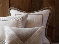 Beautiful Samuel and sons trims adding fine detail to plain cushions