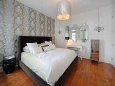 This urban bedroom makes a serious statement with its gorgeous foiled patterned wall!