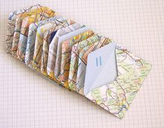 Make mini envelopes out of maps to store things like favors or after-dinner mints at a wedding. You can als...