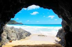 A picture perfect view from Blinkie Beach cave. Looking out onto silky, smooth sand and sapphire sea.    Click the image to book your once in a lifetime opulent island escape with Arajilla Retreat.  Instagram I  @dahnalea