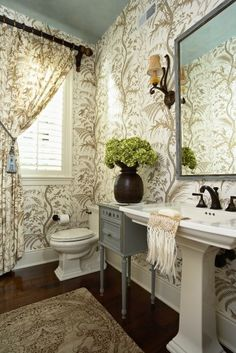 Shutters, ceiling color, large print wall paper  traditional powder room Powder Room