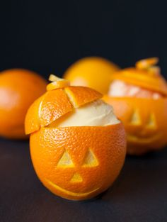 Mmmm, a frozen treat of orange sherbet, frozen neatly inside these amazing jack-o-lantern oranges! #Halloween #dessert