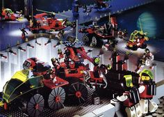 """M:Tron is a subtheme of the LEGO Space theme and started after Futuron in 1990 and lasted until 1993 along with Blacktron. In an effort to increase interactivity, LEGO introduced magnets in the next Space theme, M:Tron, who took over the """"civilian"""" role of the Futuron space races. Vehicles in this set, distinctive for their red hulls, gray trim and neon-green canopies, are devoted primarily to mining out precious ores. They often featured crane-like attachments with magnets for picking up..."""