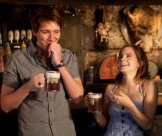 hermione and fred (or george) enjoying some butterbeer