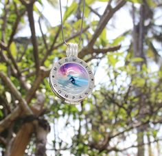 A surfer rides a silver wave as an electric pink sun sets behind him. Let this Circles of Love and Protection interchangeable coin disc give you the freedom to glide where you want in life with the freedom you deserve.