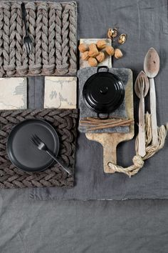 I love everything about this image. From the huge knit place mats to the individual size enamel oven to table dishes.  I've been loving those since the moment I laid eyes on them.  (I think it was in William-Sonoma years ago.)