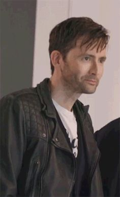 David Tennant. He looks so good. I love his hair, and that jacket looks so hot on him. :D