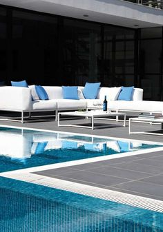 Relax and enjoy the company of your guests in contemporary style atop the Bloc Collection by Gloster that boasts plush and waterproof fabric to last for seasons to come.