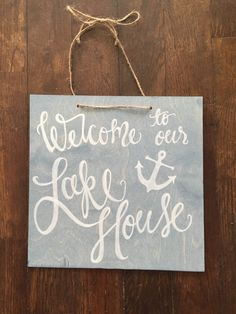 A personal favorite from my Etsy shop https://www.etsy.com/listing/226200381/blue-welcome-to-our-lake-house-sign
