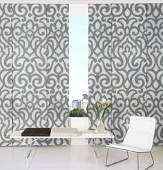 Panel System. I really think this looks great  in certain rooms. ots of color and fabric options available. pannels slide on a track-Almost like Asian screens .