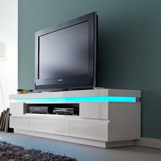 Odessa 5 drawer lowboard TV stand in high gloss white with led - 20201 shop modern & contemporary white high gloss TV stands, TV units, cabinets & wall entertainment. Media Storage, Cube Storage, Bookshelf Storage, Deco In Paris, Modern Corner Tv Stand, Led Tv Stand, Tv Stand With Led Lights, Living Tv, Wooden Tv Stands