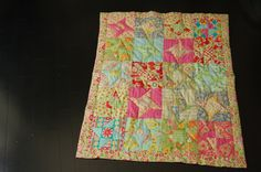 Spinning stars and Friendship stars quilt for new granddaughter. Hand quilted