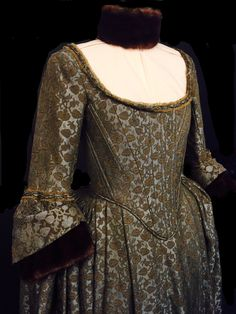 Claire's Green Brocade gown, worn to the banquet for the Duke of Sandringham at Castle Leoch | Outlander S1bE10 'By the Pricking of My Thumbs' on Starz | Costume Designer TERRY DRESBACH www.terrydresbach.com