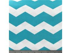 New idea! Sew a patterned fabric onto the reverse side of a solid coverlet for a pop of color on your bed. (Hobby Lobby: APT1-7 Turquoise & White Chevron Stripe Fabric.)