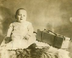 William Moses Helms, the Iron Mountain Baby, at about six months old in early 1903. A farmer in Washington County, Mo., found him wedged into the valise along the Iron Mountain Railroad line near the Big River on Aug. 14, 1902, when the boy was about five days old. William Helms, the farmer, and his wife, Sarah, adopted and raised the boy, whose biological parents were never found. The small piece of luggage apparently was tossed from a passenger train from or near the bridge over the Big…