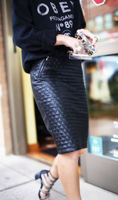 Sweatshirt + Leather skirt.