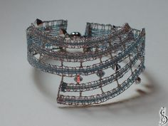 Bracelet nr. 10433b     Light blue silk and medium dark silver. Crystals Swarovski Price: € 30  Other color variations are in the catalog.  ............................  Protected by copyright!