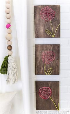 Charm is at your fingertips with this string art project! 1) Stain wood planks and let them dry completely. 2) Sketch various flower patterns onto wood, then hammer nails into the board along the outline of each sketch. 3) Tie a knot on one nail and begin twisting string along the nails. 4) Once you've achieved the desired look, tie off the string. TIP: Secure the knots with craft glue for extra hold!