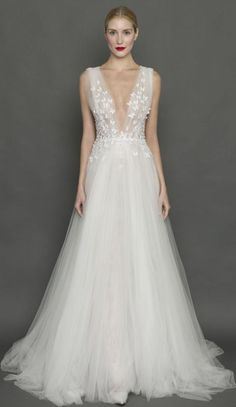 Elegant plunging neckline floral applique tulle wedding dress; Featured Dress: Francesca Miranda