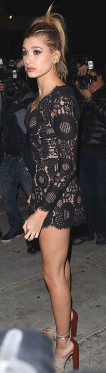 Who made Hailey Baldwin's black lace romper and suede sandals?
