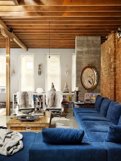 blue velvet sectional, wood beams and exposed brick....