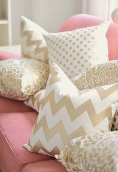 gold chevron patterns and light pink!  Perfect for a girls room or hang out room!