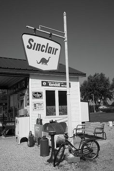 Route 66. Vintage Sinclair gas station on old Rt. 66 in Missouri. Includes sign and rusty bike.