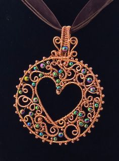 """Hearts and Lace"" - Copper wire wrapped pendant with rainbow hematite. by Arte Laboratae, Katalin KB Walcott"