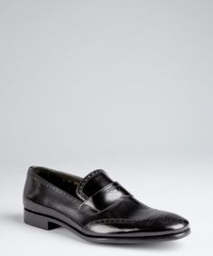 I was gonna buy the new iphone this week, but that can wait. Prada: Black Shined Leather Wingtip Loafers