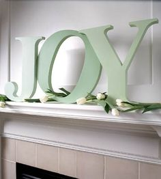 Simple, pretty Christmas mantel idea (different flowers needed!)