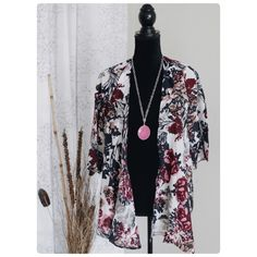 """Floral Print Kimono Chiffon-NWOT Thin NOT winter Kimono. Floral print boutique brand chiffon. Material is polyester. Tag is L, fits to Medium.  Please refer to measurement for the closest size to yours  cross shoulder 15"""", chest width about 39""""/ 19"""" laying flat, body length 28"""", sleeve 15"""".NWOT Boutique brand Sweaters Cardigans"""
