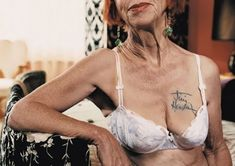 Okay, old lady tits are icky but the fact she has Jimi Hendrix's autograph tattooed on her is beyond badass and I envy her.